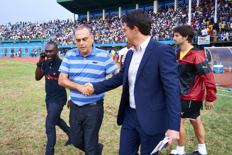 Full time: Head Coaches Avram Grant (Ghana) and Johnny McKinstry (Rwanda) congratulate each other on a good game [Rwanda Vs Ghana AFCON2017 Qualifier, 5 Sep 2015 in Kigali, Rwanda.  Photo © Darren McKinstry 2015