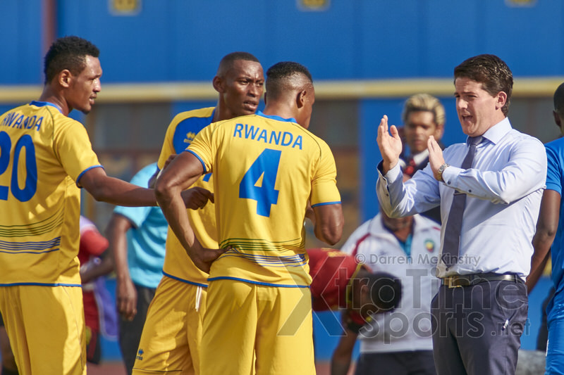 Coach McKinstry speaks to players following Tuyisenge's first equaliser. [Rwanda v Mozambique, AFCON 2017 Qualifier, 4 June 2016 in Kigali, Rwanda.  Photo © Darren McKinstry 2016, www.XtraTimeSports.net]