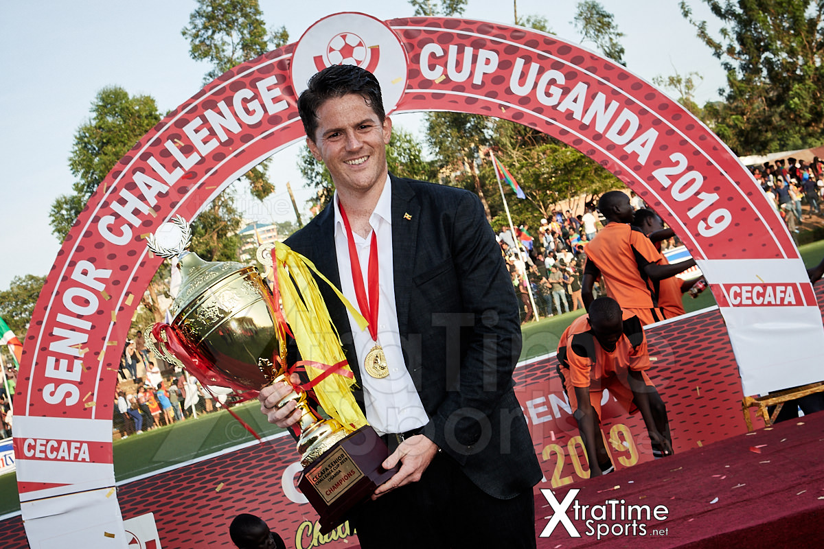 Coach McKinstry (Head Coach, Uganda) with the 2019 CECAFA Senior Challenge Cup.   Photo: XtraTimeSports (Darren McKinstry)